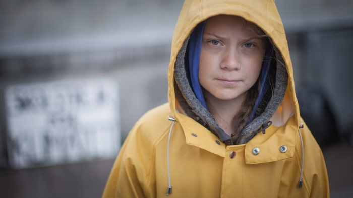 Greta Thunberg in yellow rain coat